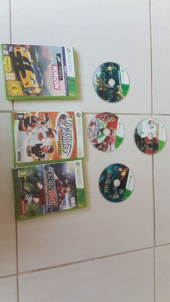 Used Xbox 360 with 7 games in Dubai, UAE