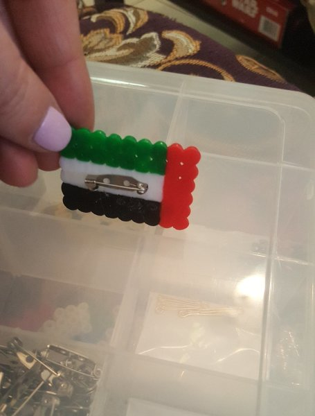 UAE flag with pin