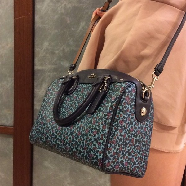 Used Authentic coach floral bag and wristlet in Dubai, UAE