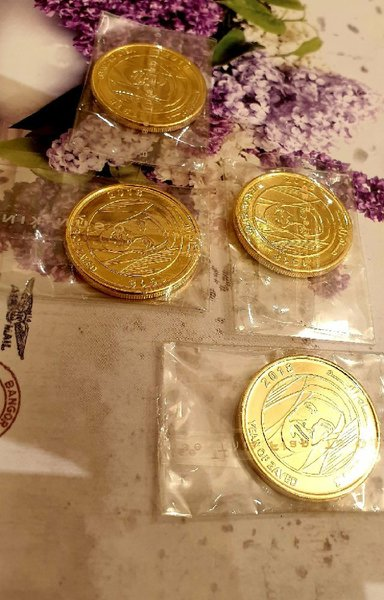 Used 4 coins ( gold plated) new🔔🔔🔔 in Dubai, UAE