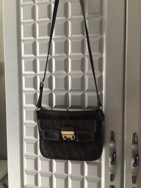 Used DKNY sling bag - authentic in Dubai, UAE