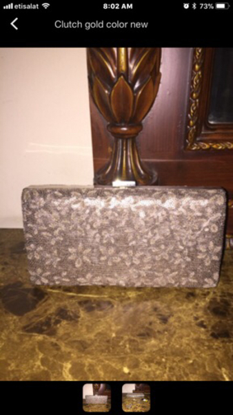 Used Two clutch in gold colors in Dubai, UAE