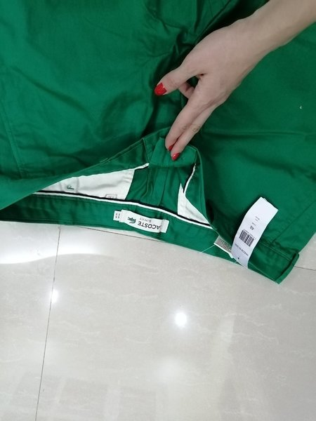 Used Green Authentic Lacoste pants size 38 in Dubai, UAE