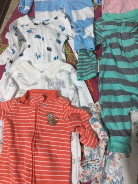 Used Carters new born baby sleep suits 12 pc in Dubai, UAE