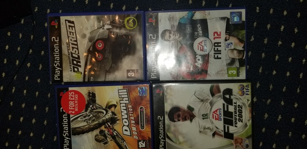 Used ps2 + 4 CD + console and controllers in Dubai, UAE