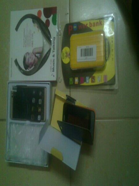 Used Bundle  Offer Two Box Pack Mobile One Power Bank Thirty Thousand MhAnd Bluetooth Headphone Brand N in Dubai, UAE