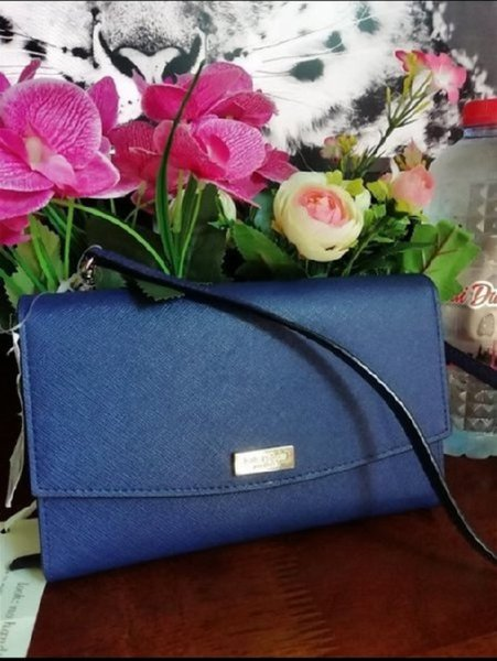 Used Authentic Kate spade sling wallet in Dubai, UAE