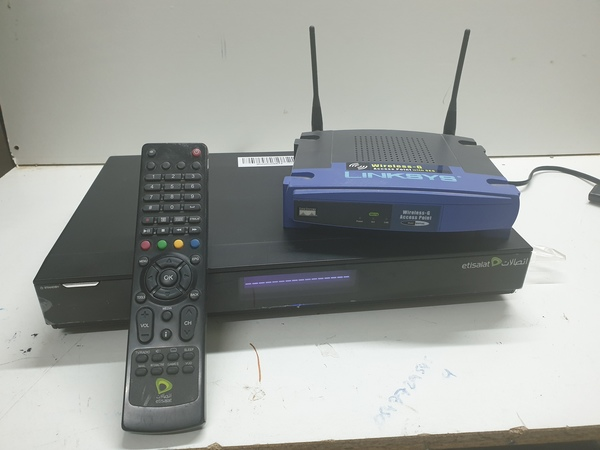 Used TV receiver and router bundle in Dubai, UAE