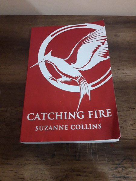 Used Catching fire by Suzanne Collins in Dubai, UAE