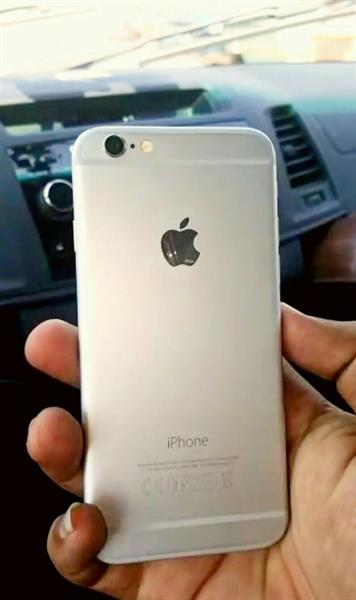 Used Iphone 6 One Twenty Eight GB  Silver With Box And Charger Adapter And USB Cable Few Scratch Corner. in Dubai, UAE