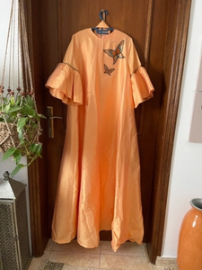 Used Orange party dress size M in Dubai, UAE