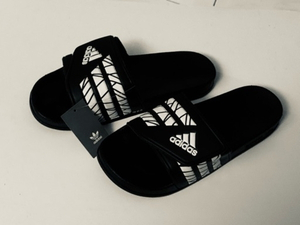 Used Adidas slippers 44 (sizes 40-45) in Dubai, UAE