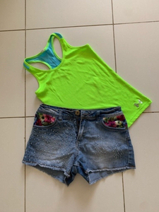 Used Top by under armour and guess shorts in Dubai, UAE