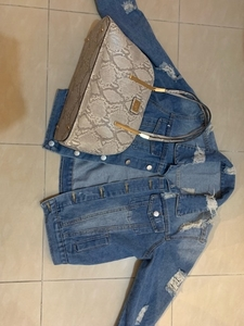 Used Hand bag and jeans jacket all in one in Dubai, UAE