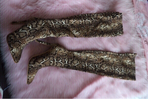 Used Knee high snakeskin boots in Dubai, UAE