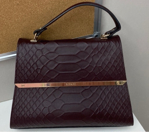 Used RIPANI BRAND MAROON BAG in Dubai, UAE