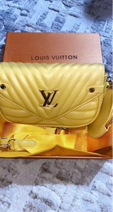 Used LV yellow pochette  in Dubai, UAE