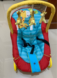 Used Baby rocking chair with hanging giraffe in Dubai, UAE