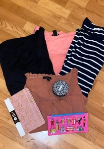 Used Clearance (4 shirts) 2 pouches 1 book in Dubai, UAE