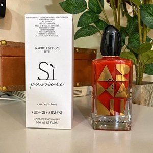 Used Si passione by Georgio Armani for her in Dubai, UAE
