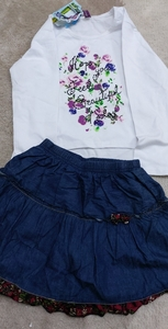 Used baby white floral shirt wid denim  skirt in Dubai, UAE