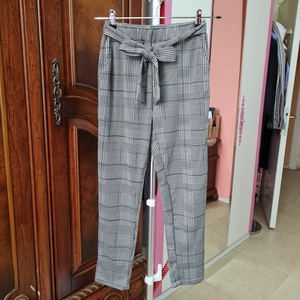 Used size M pants with belt in Dubai, UAE
