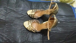 Used Golden heels 39size in Dubai, UAE