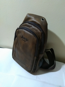 Used Leather USB Charging chest bag brown in Dubai, UAE