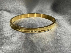 Used Tiffany 10k gold bangle and cartier ring in Dubai, UAE