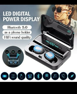 Used F9 super earbuds tws  attached Powerbank in Dubai, UAE